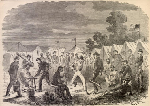 Troops dance in camp the evening before a campaign
