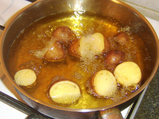 Deep frying red potato halves