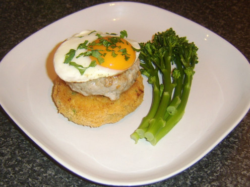 100% pork burger on a breaded potato cake with fried egg and tenderstem broccoli