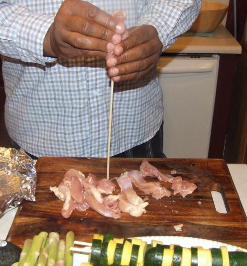 Daniel Prepares Chicken On A Stick.