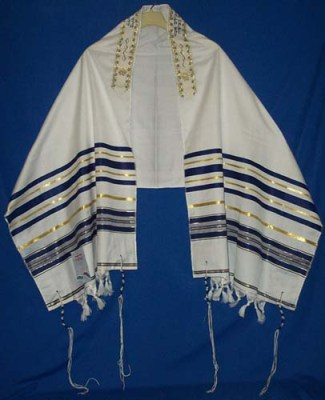 The knots in the tzitzit are place on the four corners of the tallit