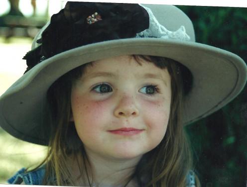 Little girl in hat/ Kinder Spirits