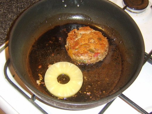 Pineapple ring is briefly fried with sweet and sour pork burger