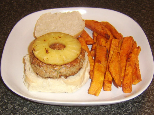 Sweet potato fries are plated with burger