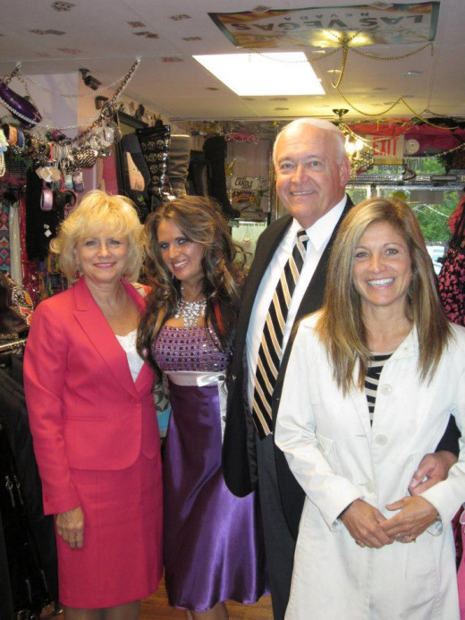 Tori Thompson with city officals inside POSH by Tori BOUTIQUE, Michigan