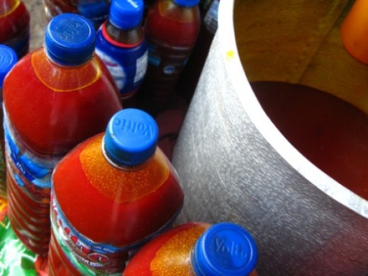 Bottled red palm oil is used to make many West African dishes