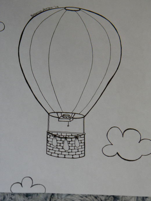 A hot air balloon. My favorite part is the clouds.