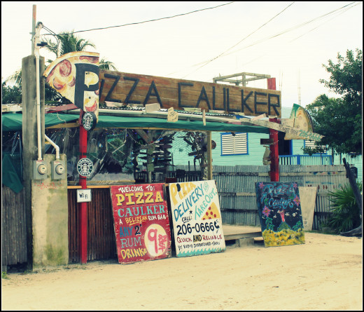 Pizza Caulker has good pizza and free shots with the owner.