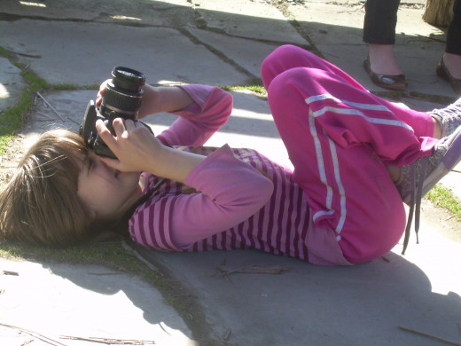 My daughter is coached by her Papa as she practices her photography in a gazebo at Tower Hill Botanical Garden.