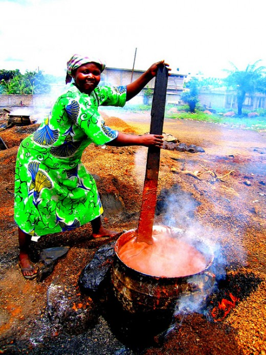A woman processing palm oil in West Africa