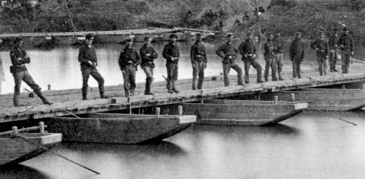 Engineers stand on the pontoon bridge they constructed