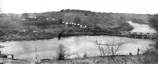 Infantry and supply wagons cross a pontoon bridge over the Rapidan River in Virginia.