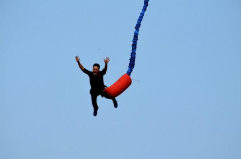 Man bungee jumping.