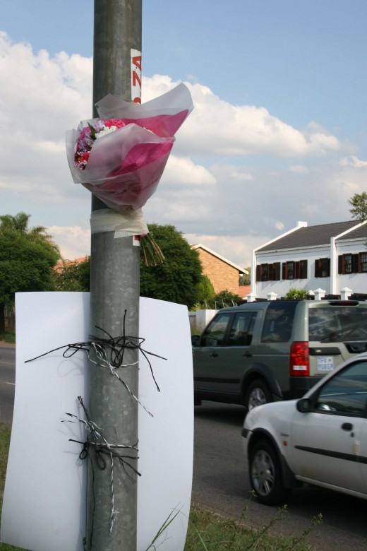 Flowers for Bernadine on a lamppost near the scene of the accident