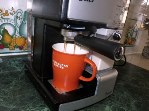 Next, the machine pulls 1-2 espresso shots.