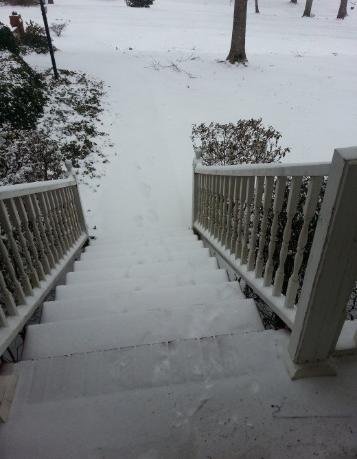Snow covered the steps leading out of my front door.