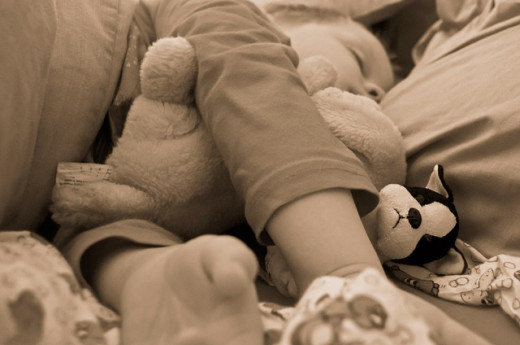 Cover mattresses and pillows with allergy covers and limit stuffed animals to reduce allergens in bedrooms