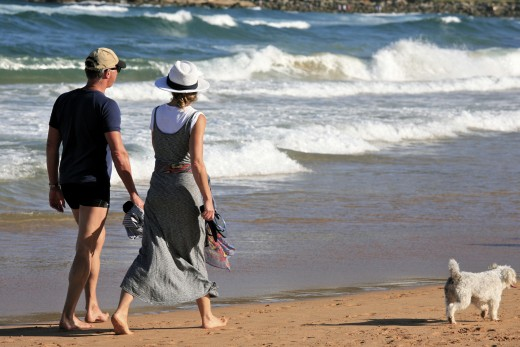 Couples strolling on the beach.