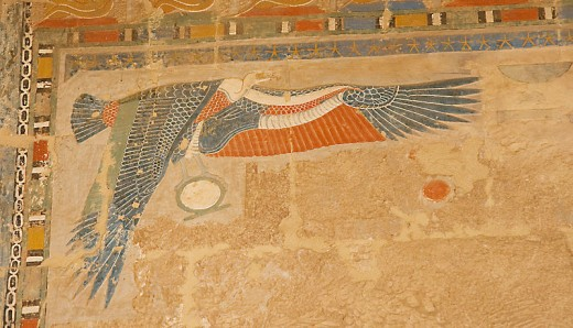 Depiction of Nekhbet, Vulture Goddess, holding a solar disk on the wall of Deir el-Bahri temple.