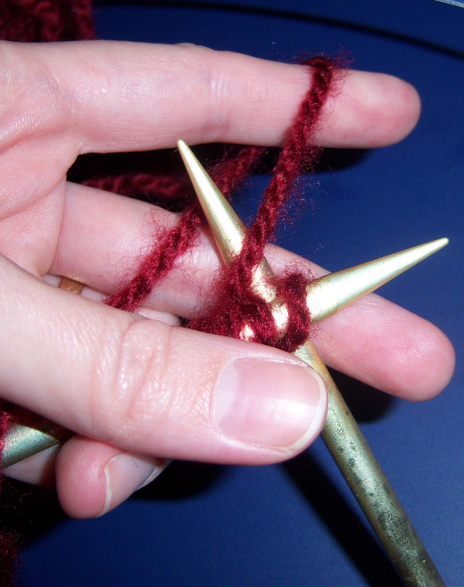 Loop yarn over the back needle.