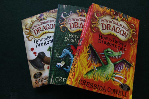 Three of the books in the Train a Dragon series