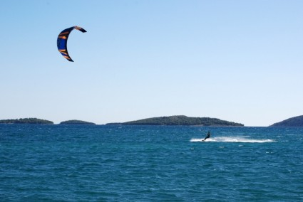 Trying different water sports on holiday like wind surfing, water skiing, para gliding, can be fun!