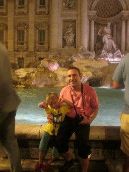 My son and his dad at the Trevi Fountain