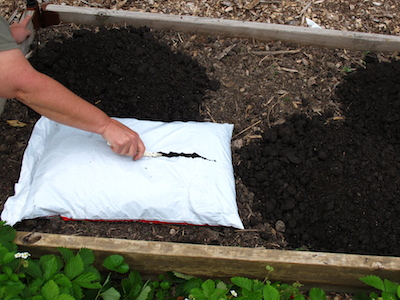 Slit open bagged soil with a plastic picnic knife. Keep this cheap bag opener in your garden tools box.