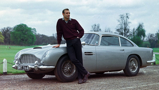 Sean Connery as James Bond and his Aston Martin DB5.
