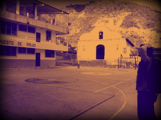 Standing in the main square in Santa Cruz after a steep climb up from the lake.