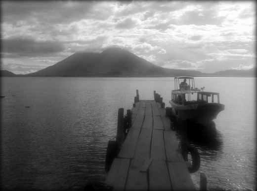 Lancha waiting for us at the Santa Catarina jetty. View of volcano in the background.