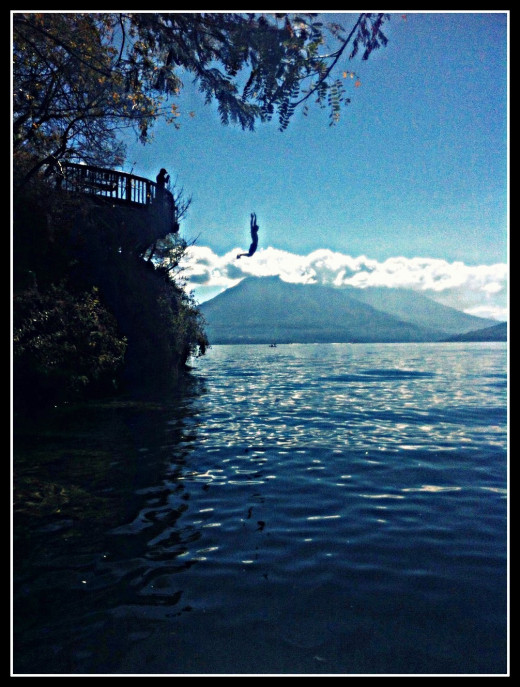Andy takes the plunge in San Marcos against the backdrop of the lake's three volcanoes.