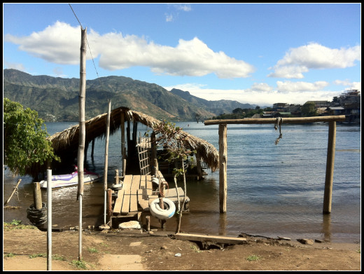 Waiting at the the half sunken jetty in San Pedro for our lancha to take a Xmas Eve tour of the lake.