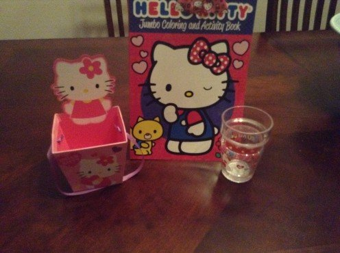 Hello Kitty cup, basket, and activity book.
