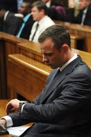 Oscar Pistorius checking his watch on day 1 of the trial