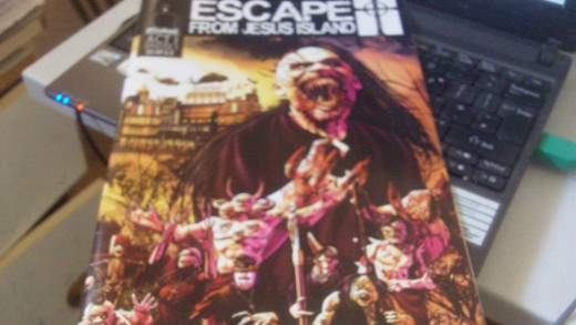 The copy of issue 1 of Escape from Jesus Island sitting on my laptop. Escape from Jesus Island Copyright Wisdumb Productions 2014.
