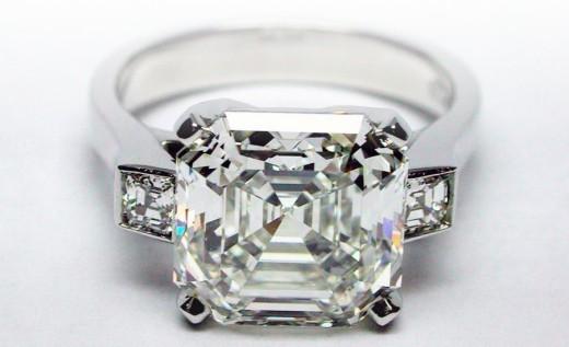 Engagement ring with three Asscher cut diamonds.