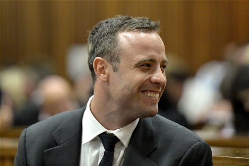 Oscar Pistorius finds something funny in court