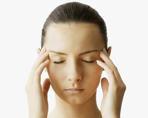Massage your face to ease tension, clear breathing passages, and subdue headaches.