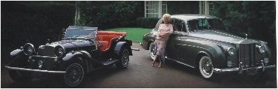 Phyllis Dillar with her two classic cars