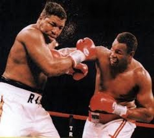 Larry Holmes (Right), seen here pounding on Ray Mercer, began his comeback by fighting on TNF.