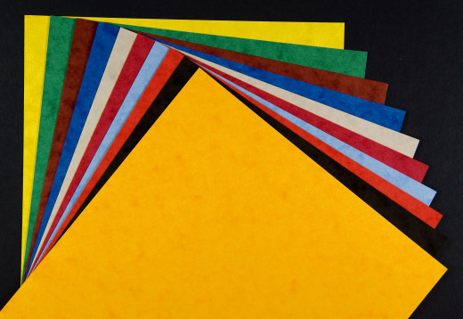 Card stock can create a colourful surface for a handmade board game.