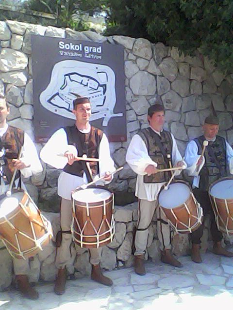 Men playing music with the traditional drums