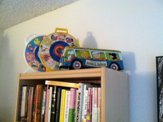 "Vintage toys pictured here: two ""See and Say"" toys from our childhoods, and the ""Peanuts Talking Bus, which is very rare"