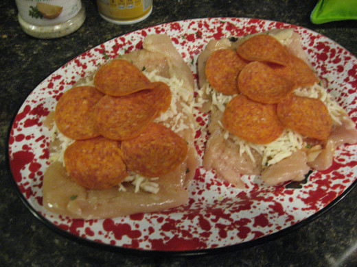 Add Mozzarella cheese and sliced pepperoni.