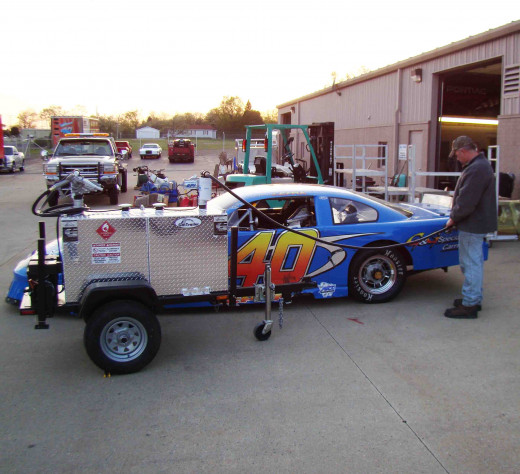 A gas trailer offers you a convenient way to refuel a race car.