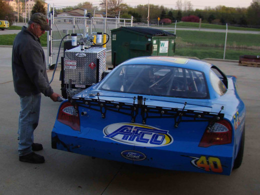 You can refuel your race care whenever you want if you have a gas trailer.