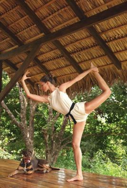 Gisele Bundchen doing a yoga pose. This supermodel is saving forests, rivers, empowering teenage girls and launching a natural beauty line, Sejaa.  She is still the highest paid model in the world.