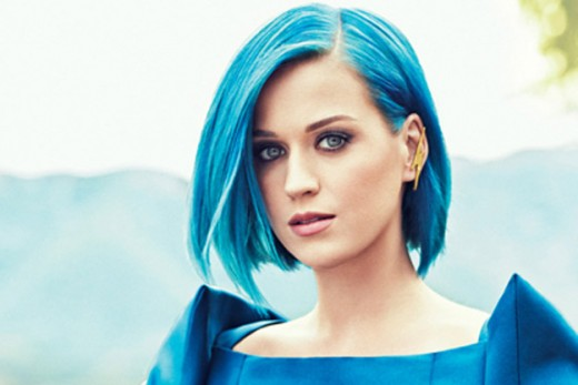 Katy Perry does yoga. Please note that doing yoga does not cause your hair to turn blue. I like her the best with blue hair.