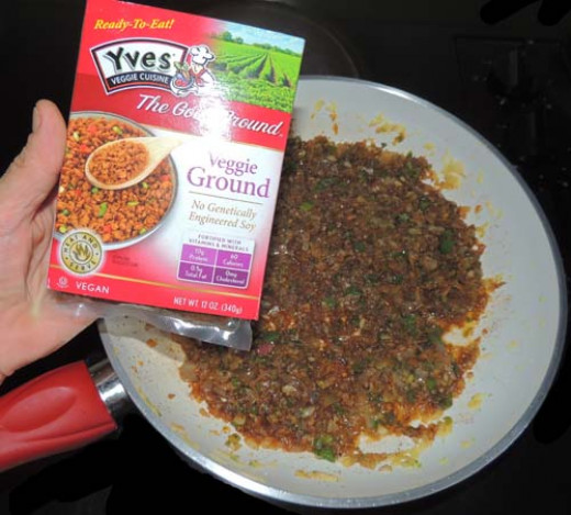 "add your soy protein & wheat ""meatless"" crumbles. Mix well, simmer a little, and remove from heat. Set aside."